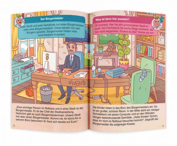"""Aufgeschlagenes Lernheft """"VerstehMal: Das Rathaus Junior"""" mit lustigem Bild vom Bürgermeister"""